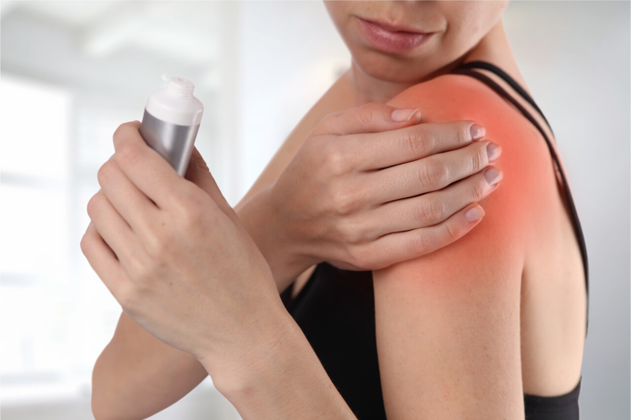 woman applying pain relief gel