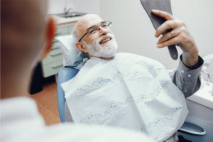 man on a dentist chair smiling