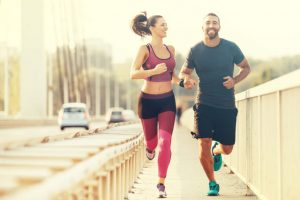 couple jogging for their morning workout routine
