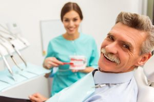 The senior patient visits his dentist to get a denture.