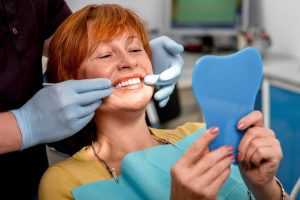 The patient has a successful dental implant.