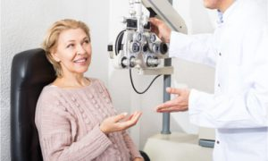 The senior patient gets an eye checkup regularly.